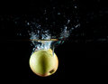 Apple water splash Royalty Free Stock Images