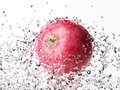 Apple with water splash isolated on white Royalty Free Stock Photography