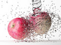 Apple with water splash isolated on white Royalty Free Stock Photos