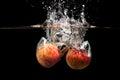 Apple with water splash on white Royalty Free Stock Photos