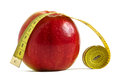 Apple width measuring tape red over white the concept of diet and fitness Royalty Free Stock Images