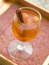 Apple wine or cider with cinnamon stick selective focus Royalty Free Stock Image
