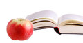 Apple of wisdom the at the side a book Stock Photography
