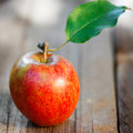 Apple on wooden board Stock Images