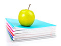 Apple on writing books school concept Stock Image