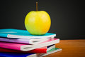 Apple on writing books school concept Royalty Free Stock Photos