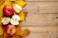 Apples on autumn leaves wooden background Stock Photos