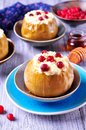Apples baked with cheese and cranberries poured honey. Healthy breakfast. Royalty Free Stock Photo