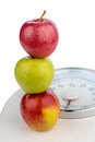 Apples on a balance several for people symbolic photo for diet and healthy vitamin rich diet Stock Photography
