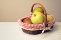 Apples in the basket on the table horizontal Royalty Free Stock Photo