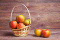 Apples in basket on wooden boards Royalty Free Stock Photo