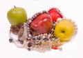 Apples, beads, luxurious and treasures Royalty Free Stock Photos