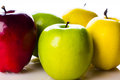 Apples of different colors on the white background Royalty Free Stock Photos