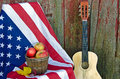 Apples on flag with guitar fall leaves american by old barn Stock Images