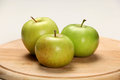 Apples green on a wooden plate Stock Image