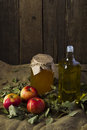 Apples with a jar of honey and a bottle of olive oil Royalty Free Stock Photo