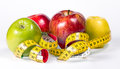 Apples and measuring tape dieting diets Stock Image