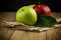 Apples in a napkin on wooden background Royalty Free Stock Photo