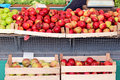 Apples organic in wooden crates on market stall Stock Photo