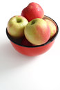 Apples in a red dish are isolated Royalty Free Stock Images
