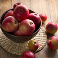 Apples on a rustic kitchen table Stock Photo