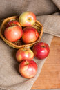 Apples on a sacking on a wooden table Royalty Free Stock Photos