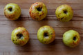 Apples six of ripe on a wooden surface close up Royalty Free Stock Photo
