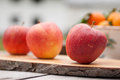 Apples some fresh on a wood dischn Royalty Free Stock Photography