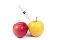 Apples and syringe (dope),  on white Royalty Free Stock Photography