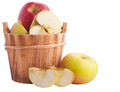 Apples in wooden bucket over white Stock Image