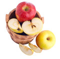 Apples in wooden bucket over white Stock Images