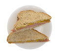 Applewood smoked ham sandwich on a plate Royalty Free Stock Photo