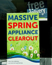 Appliance clearout massive spring clear out sign in shop window Stock Photography
