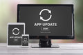 Application update concept on different devices Royalty Free Stock Photo