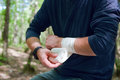 Applying an arm medical bandage in a forest during the journey Stock Photography