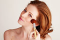 Applying Blusher To Cheekbone Royalty Free Stock Images