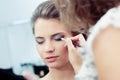 Applying eyeshadow Royalty Free Stock Photo