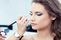 Applying eyeshadow Royalty Free Stock Photo
