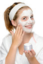 Applying face mask fingers smiling blonde girl hand Stock Photography