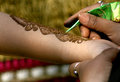 Applying henna dye prepared from the plant tree for temporary tattooing Stock Photography