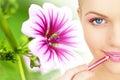 Applying lipstick using lip concealer brush Stock Photos