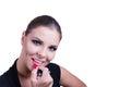 Applying red lipstick beautiful girl Stock Photography