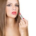 Applying red lipstick gorgeous young caucasian woman looking at camera isolated on white background Royalty Free Stock Photography