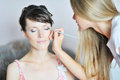 Applying wedding make-up Stock Photo