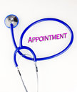 Appointment text inside a blue stethoscope on a white background Royalty Free Stock Photo