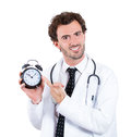 Appointment time closeup portrait smiling confident male healthcare professional physician nurse dentist with stethoscope holding Stock Images
