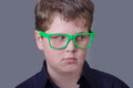 The appraiser surprised boy wearing green glasses Stock Images