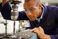 Apprentice Engineer Using Milling Machine Royalty Free Stock Photo