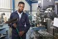 Apprentice In Engineering Factory Sweeping Floor Royalty Free Stock Photo