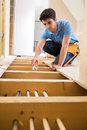 Apprentice Plumber Fitting Central Heating System In House Royalty Free Stock Photo
